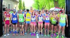 Sánchez y Paula Mayobre reinan en la Media Maratón del Cerrato