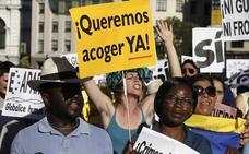 Miles de personas se manifiestan en Madrid a favor de la acogida de refugiados