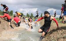 Medio millar de corredores participan en la Carrera de Combate en la base de Santovenia