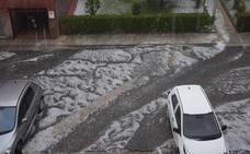 Una tromba de granizo anega varias calles de Guardo