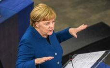 Merkel apuntala frente a Trump la apuesta de Macron por un ejército europeo